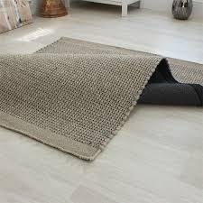 woven wool rug enzofeltedwoolruglightgreyroomshot05jpg woven wool rugs for