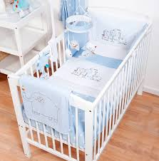 hello ernest cosi cot 4 piece bedding set in blue on a cot in a bedroom