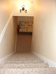 basement stairwell lighting. The Stairs To Basement Have Been Enclosed And Carpeted. Walls Are Finished Nicely With Molding Detail A Beautiful Light Fixture. Stairwell Lighting