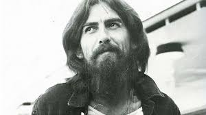 while all of the beatles grew out their beards in the second half of their career george harrison really stuck with the look and made it part of his iconic