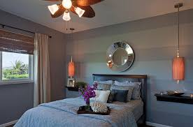 ... Contemporary bedroom in gray with striped accent wall [From: JSID]
