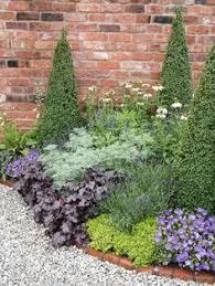 Small Picture Bed design topiary espalier raised brick planter LA Design