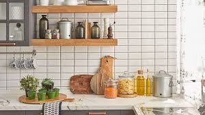 marble countertops with neatly organized bottles pots and wooden boards arranged on them with
