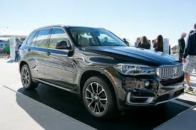 bmw 2014 x5 black. sparkling brown metallic paint job that adorned the 2014 modelu0027s first photos is quite stately and a bit unassuming in person bright sunlight it still bmw x5 black