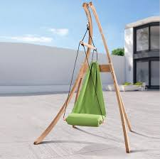 chic wooden stand plan with unique green hammock chair design
