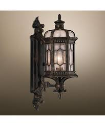 shown in forged bronze finish and textured seedy glass panes glass