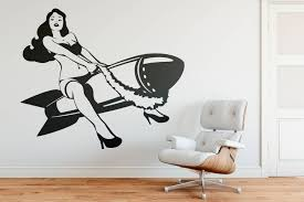 y pinup girl riding a wall decal old iconic and vintage cheesecake photo decal atomic appeal beautiful woman