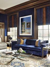 royal blue living room with rich brown and creamy accents
