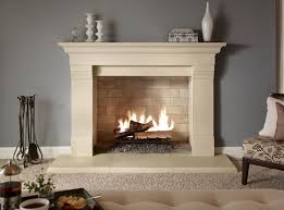 modern fireplace surrounds for home interior with grey wall color and white fur rug also comfy cream fl chair idea