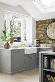 Sunshine streams in though this lovely big window in this beautiful South  London kitchen. Lead