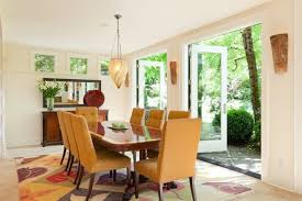 orange upholstered dining room chairs. contemporary dining room features orange upholstered chairs wooden table floral theme rug modern shade i