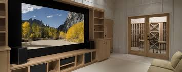large flat screen television in a wooden tv cabinet