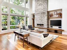 the blond hardwood floors ground this modern airy space white walls paired with white furnishings keep the space feeling light and clean while the massive