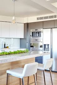 House And Garden Kitchens Minimalist White Modern Kitchen With A Garden Strip In The Counter