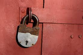 closeup of old lock on red metal garage door stock photo image of locking