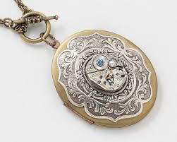 steampunk locket necklace watch movement on silver victorian leaf motif bezel with blue topaz crystal large oval locket