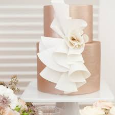 wedding cakes wrapped in modern romantic ruffles brides