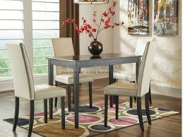 kimonte ivory chairs 5 piece dining collection ashley d250 the straight line table is sized