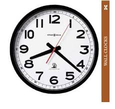 office wall clock. This Howard Miller Accuwave DS Wall Clock Automatically Sets Itself, And Adjusts For Daylight Savings Time. Office