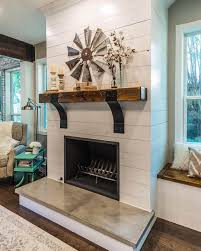 Exposed Beam Mantel with Windmill Wall Art