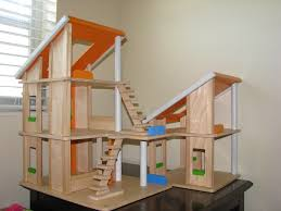 plan toys chalet dollhouse in euc with family dolls  cloth