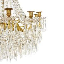 large gilt bronze and crystal antique french chandelier in the empire style in good condition for