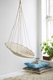the indoor version is crafted of led and tinted rattan while the nearly identical looking outdoor version is made of high resistance aluminum tubing