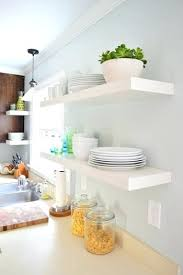 ikea picture shelf two pairs of white lack shelves hung in the kitchen with white plates