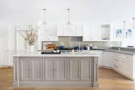 gray kitchen island with glass schoolhouse pendants
