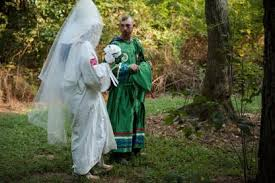 documenting social injustice ldquolittle charlierdquo of the dixie rangers of the ku klux klan displays her custom made wedding veil as her fiance watches on