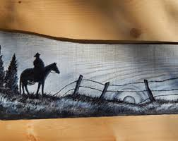 cowboy silhouette cowboy painting horse silhouette barn wood sign cowboy art horse painting cowboy wall art western painting cowboy art on horse silhouette wall art with wood horse sign etsy