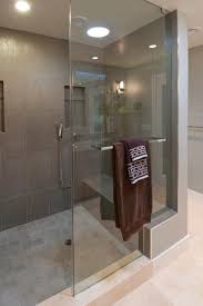 How is glass shower panel attached to the curb & mini wall? There seems to  be no clips.
