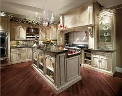 french style kitchen design idea lwith uxury crystal chandelier and beige walnut kitchen cabinet and island with black granite countertop on hardwood floor