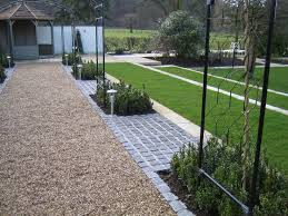 Small Picture Stabilised golden gravel garden path with dark grey granite setts
