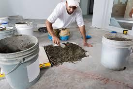 man laying tile floor