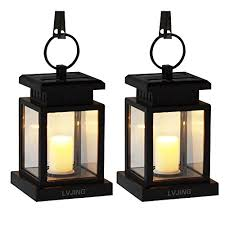 solar lantern hanging solar lights outdoor 2 pack solar garden lights for patio landscape yard warm white candle flicker auto sensor on off