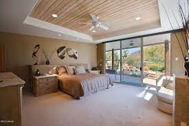 Master Bedroom with Tray ceiling, Carpet, Ceiling fan, Wood ceiling