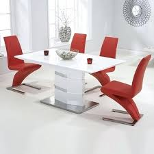 round glass dining table and red chairs also i heard is the best color for room