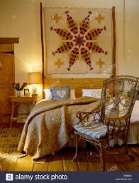 Ornate Bedroom Chairs Patchwork Wall Hanging Above Bed With Cvream Quilt In Country