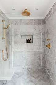 The tile professional on the job, jack miklaus, shares information on fabricating the panels and tips. Do We Regret Using Marble Tile In Our Shower Erin Kestenbaum