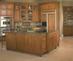 blend of natural color belmont cabinets with kitchen island