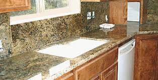 Granite Backsplash In The Form Of Large Sheets For A Seamless Look