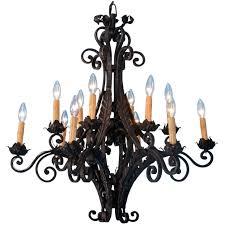 antique 12 light scrolled black iron chandelier