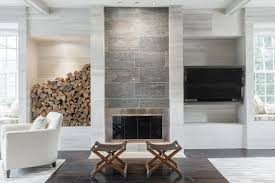 living room with stone tile fireplace