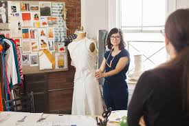 how to become a fashion designer skills you need fashion designer working in studio