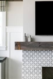 cement tile fireplace with rustic mantle