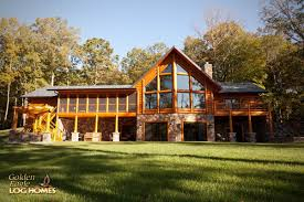prow feature wall screened porch walkout basement exterior log home by golden eagle log and timber homes