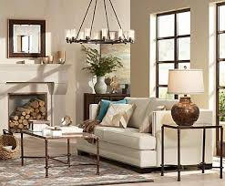 large room lighting. a large chandelier anchors cozy living room with rustic touches lighting