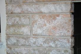 painted stone wallRemodelaholic  Restoring A Painted Stone Fireplace