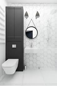 white hex tiles with black grout to highlight it and large square tiles on the floor